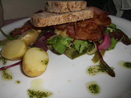 Potatoes on homebaked rye with bacon, herbs and homemade mayonnaise