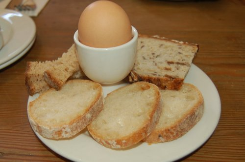 Organic soft boiled eggs with organic bread