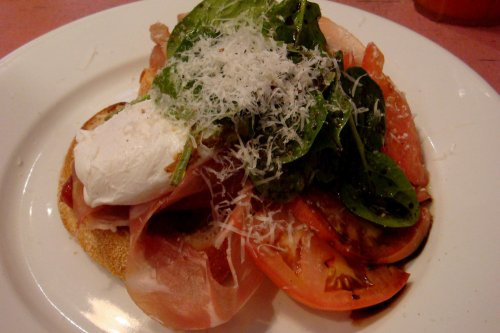 Poached eggs on toast, prosciutto, tomato relish and Pecorino