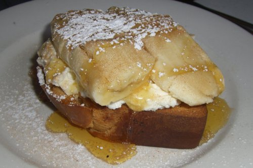 Smashed banana on toasted brioche with ricotta and honey