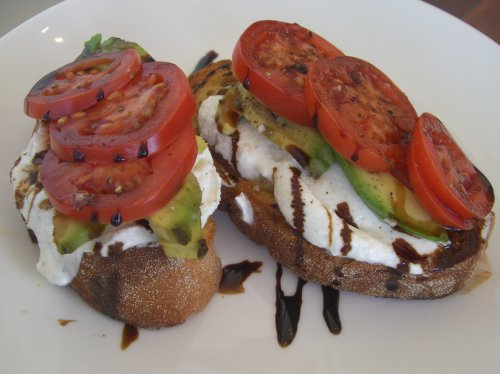 Sourdough toast with avocado, roma tomato, goats cheese and balsamic
