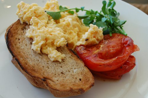 Scrambled eggs on rye toast with roast sea salt thyme tomatoes