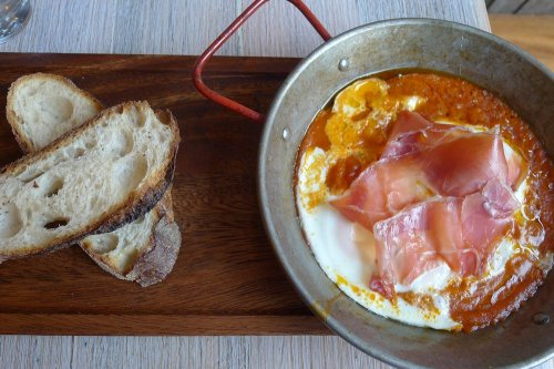 Catalan baked eggs with serrano jamon