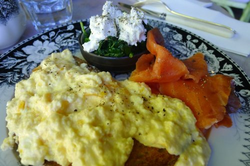 Scrambled eggs with herring caviar and sides