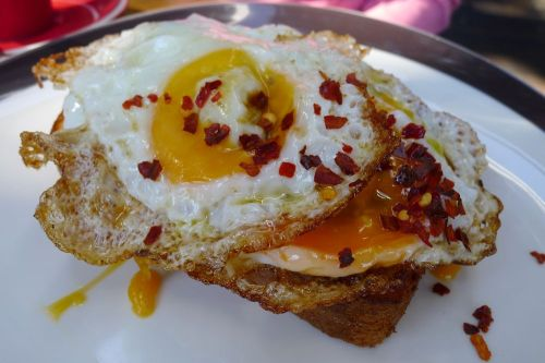 Toasted brioche, eggplant salad, fried egg, chilli