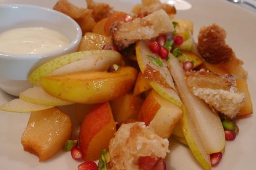 Fruit salad with sweet doughnut croutons