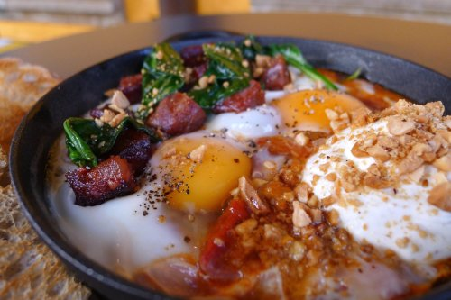 Baked eggs with chorizo and spiced yoghurt