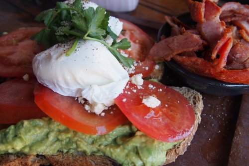 Smashed avocado and fresh tomato