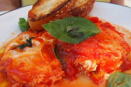 Eggs in tomato and basil