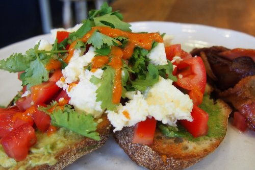 Sourdough toast with avocado, tomato, marinated feta