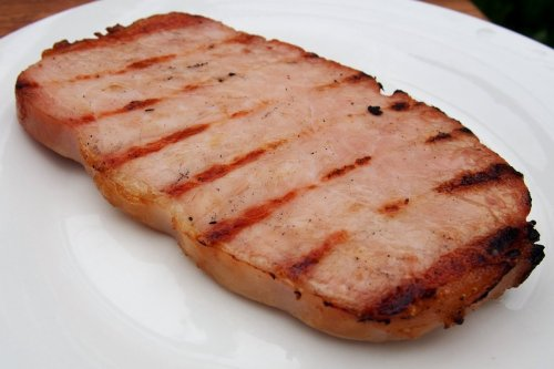 Thick grilled ham steak